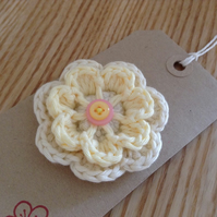 Two-layer crochet brooch in pale yellow and cream cotton