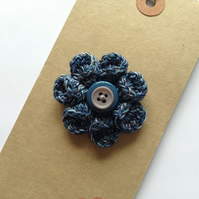 Delicate blue cotton flower corsage