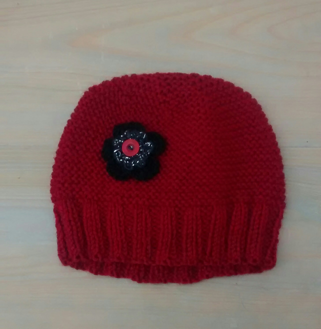 Red Hat with Black Crochet Flower