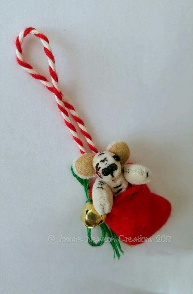 Unloved Teeny Ted in a stocking decoration