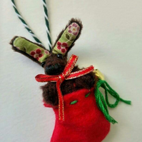 Unloved Teeny Bunny in a stocking decoration