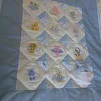 Patchwork embroidered baby quilt