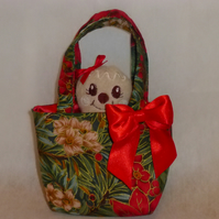 Christmas gift bag with gingerbread softie