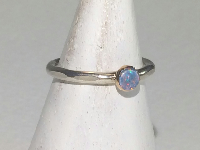 4mm triplet Opal set in 9 carat gold on silver band