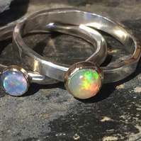 Opal cabochon ring, set in 9 carat gold on silver band