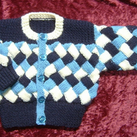 Baby boy's hand knitted jacket (ref 105)