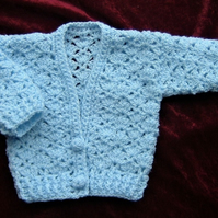 lacy crocheted baby cardigan ( ref F 942)