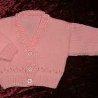 SALE ITEM....knitted pink v neck baby cardigan ( ref F 986)