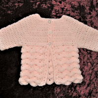 hand crocheted peach baby coat. ( ref F 99)