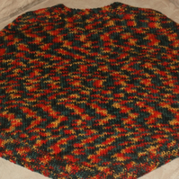 Hand knitted child's poncho