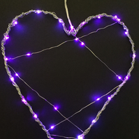 Wire heart with coloured LED lights.