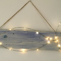 Wire heart with coloured LED lights on driftwood, wall art.