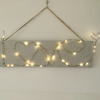 Wire  word art, Love, with coloured LED lights on driftwood, wall art.