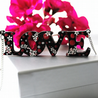 "Handmade, hand painted ""LOVE"" necklace"