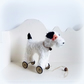 Little white Terrier on vintage Meccano wheels black ears and tail