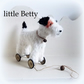 Betty a little white Terrier on vintage Meccano wheels with black ears