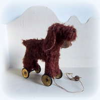 Little brown Spaniel on vintage Meccano wheels