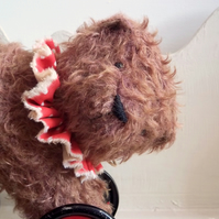 large russet mohair bear on vintage Meccano wheels