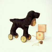 little vintage style pull-along BLACK Spaniel on old Meccano wheels