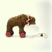 little old mohair circus bear on vintage Meccano wheels