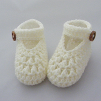 Crochet maryjane booties in a baby gift box.