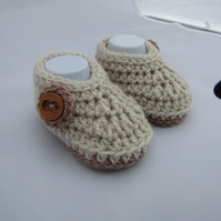 Baby boy crochet booties in a baby gift box