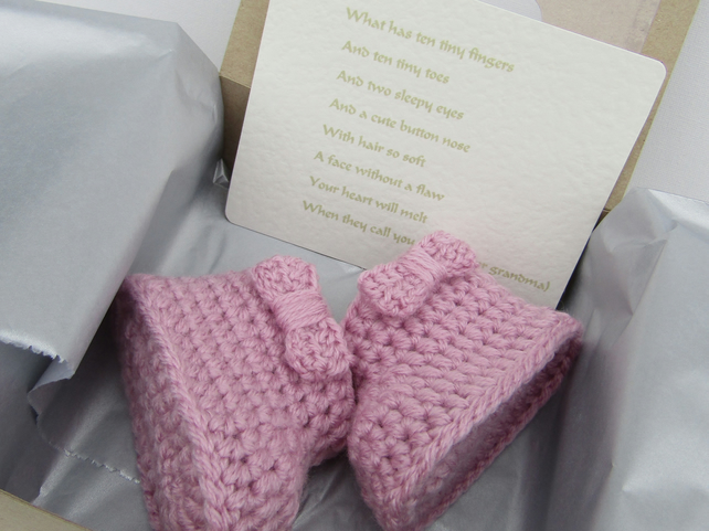 Crochet baby booties reveal gift