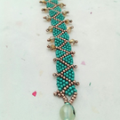 Teal and rose gold metallic zig zag, wavy beaded bracelet with sparkly crystals