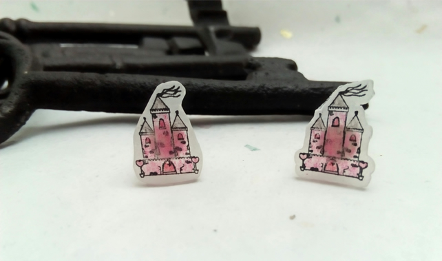 Pink Castle stud earrings on frosted shrink plastic