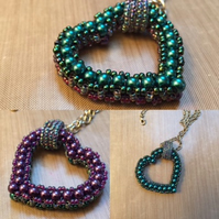 Purple and teal glass pearl beaded reversible heart pendant
