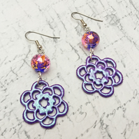Purple filigree flower wooden dangle earrings with accent glass bead