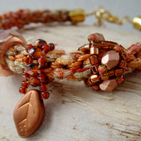 Hand braided Kumihimo bracelet with Copper beaded charms