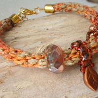 Hand braided yarn bracelet aka kumihimo with Copper beaded charms