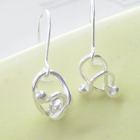 small silver swirl knot ear drops