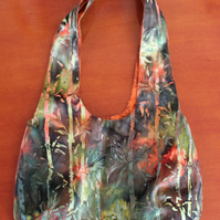 Reversible bag. Colourful modern batik fabric and orange leaf pattern.