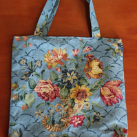Large Blue Tote Bag with bunch of flowers.