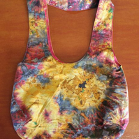 Reversible bag. Multicoloured splash print with Red and gold on inside.