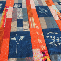 Quishion. Patchwork Quilt in a Cushion, Cyanotype & Orange.