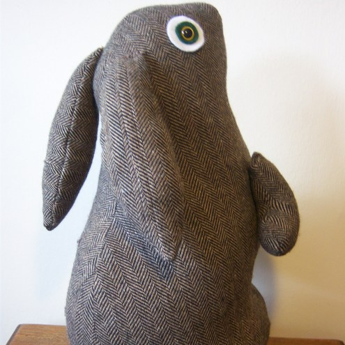 brown rabbit/green eyes doorstop