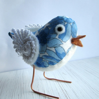 Blue bird with lace wings