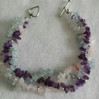 Amethyst, Aquamarine and Rose Quartz plaited Bracelet.