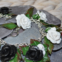 Beautiful Black and White Rose Charm Bracelet.