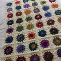 Handmade crochet blanket circle in granny square design autumnal colours