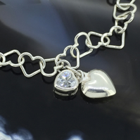 Pretty Sterling Silver and Cubic Zirconia Twin Heart Charm Bracelet