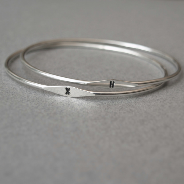 Silver oval letter bangle