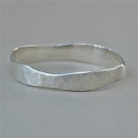 Silver hammered organic design round wide bangle