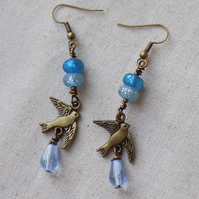Bird in flight Dangle Earrings with Blue Glass