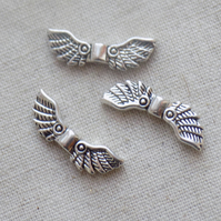 10 Silver tone Angel Wing Beads Charms 22 x 7 mm