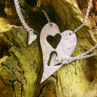 Three fine silver patterned heart pendants on sterling silver trace chains