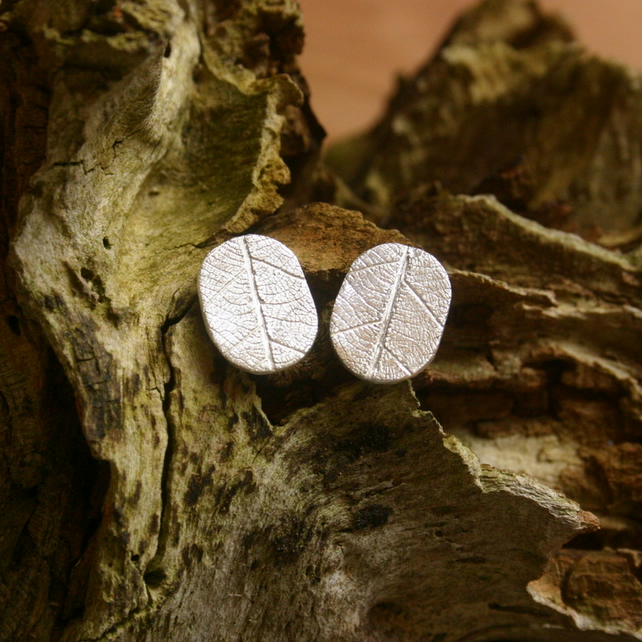 Fine Silver oval stud earrings with skeleton leaf pattern